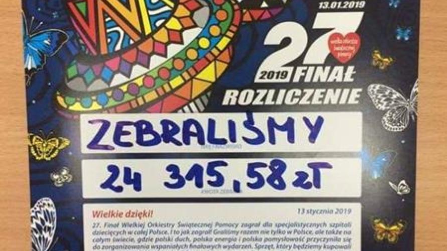 Plakat WOŚP z zebraną kwotą 24315,58zł.